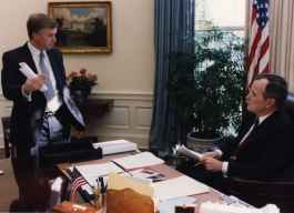 President George Bush and Vice President Dan Quayle talking in the Oval Office