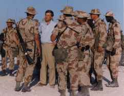 Vice President Dan Quayel speaking with troops in the desert